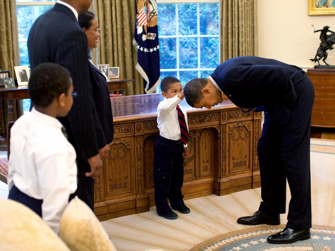 "Former White House photographer and author of ""Obama: An Intimate Portrait"" Pete Souza captured this iconic shot of a young African-American boy seeing himself in the first black president."