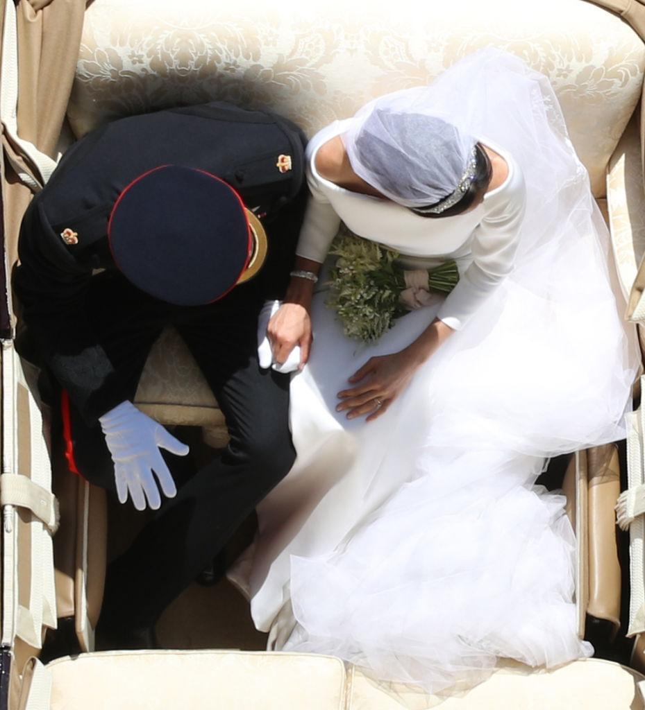 People thought this perfectly-timed shot of Prince Harry and Meghan Markle on their wedding day was taken by a drone, but it was photographer Yui Mok.