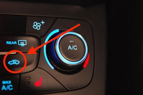 Botón de recirculación del aire del coche