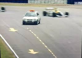 Un Ford Escort RS Cosworth en el GP de Bretaña en 1993